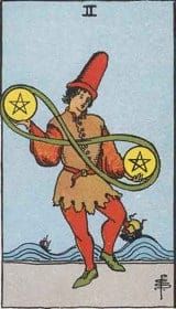 The Two of Pentacles Tarot Card Meanings - A Little Spark of Joy